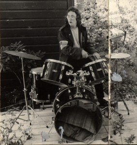 author Stojanovic participates in drumkit therapy session at Cherry Farm following the disastrous Neon Shitcake incident