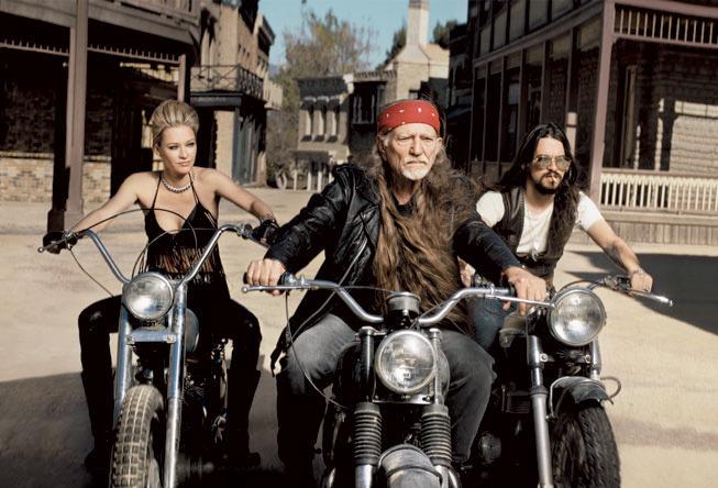 playingsingles32 Willie Nelson & girl on motorbikes