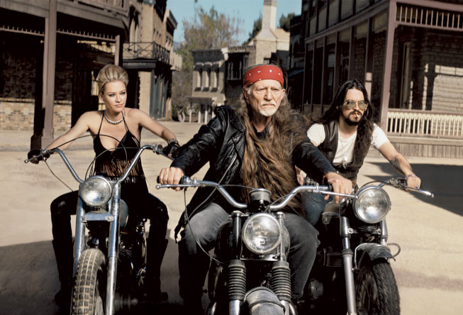 playingsingles32 Willie Nelson & girl on motorbikes